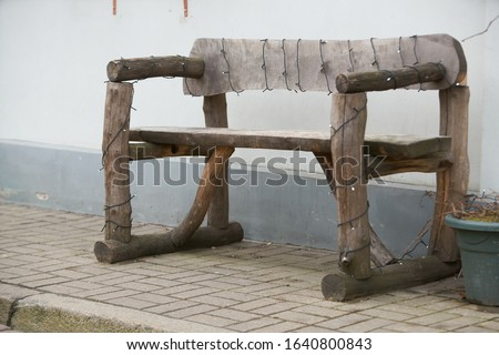 Ancient rural bench from logs. Isolated over white. Roughly hammered together wooden bench. Stock fotó ©