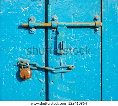Ancient rusty door latch with padlock