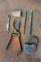 Ancient rusty tools on a metal surface. Steampunk style.