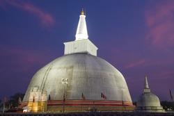 Ancient Ruwanweli Maha Seya Dagoba close-up on evening twilight. Anuradhapura, Sri Lanka