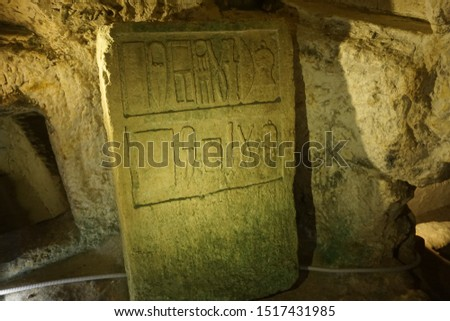 Ancient scripts/engravings inside the St Paul's catacombs in Rabat of Malta