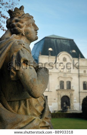 ancient sculpture in front of Humenne castle, Slovakia. vertical photo