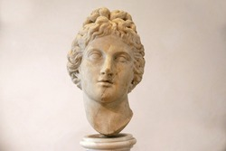 Ancient sculpture of the head of Apollo in the baths of Diocletian (Thermae Diocletiani) in Rome. Italy