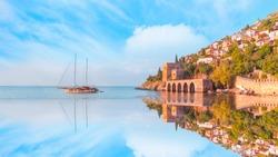 Ancient shipyard next to Red tower ( Kizil Kule) in Alanya peninsula - Antalya, Turkey