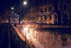 Ancient staircase of Tiber river in Rome illuminated in the night