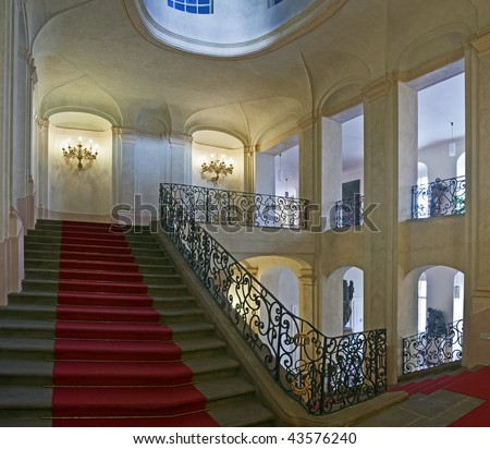 ancient staircase with red carpet
