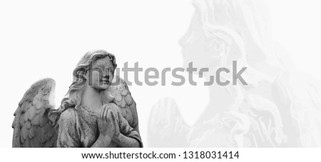 Ancient statue of angel guardian praying. Faith, religion, death, resurrection, theology concept. #1318031414