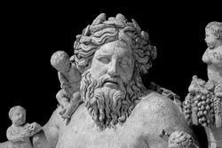 Ancient statue of Nile river god. Head and shoulders detail of the ancient art sculpture bearded man isolated on background.
