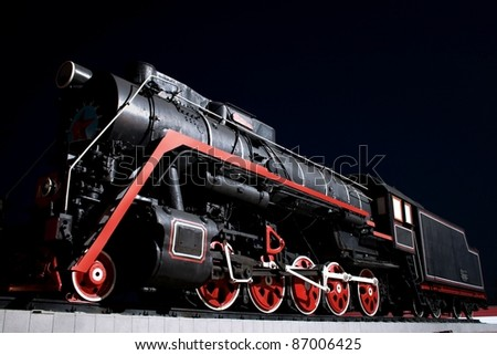 Ancient steam locomotive in night