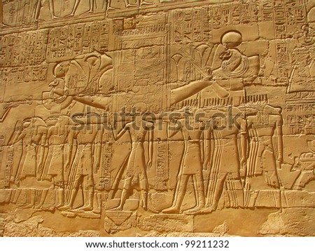 Ancient stone carved Egyptian hieroglyphics in Karnak temple, Luxor, Egypt
