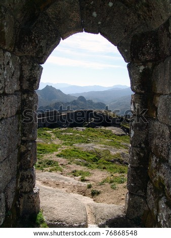 ancient stone door historic with mountains in background