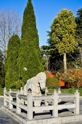 Ancient stone horse in enclosure at white horse temple Luoyang China