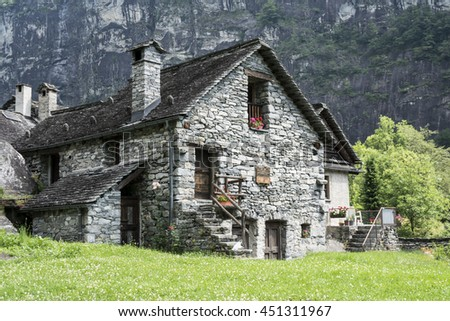 Ancient stone house in the Swiss Alps #451311967