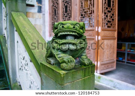 Ancient stone lion in a Buddhist temple Chongqing city China - stock photo