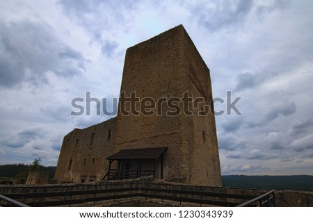 Ancient stone tower in Landstejn Castle against cloudy sky. It is the oldest and best preserved Romanesque castle in Europe. Travel and tourism concept. South Bohemian, Czech Republic.