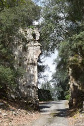 Ancient stone tower, part of the ruins the ghost town of Oppido Vecchia in the National Park of Aspromonte, Calabria, Italy