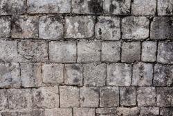 Ancient stone wall in Chichen Itza, Mexico