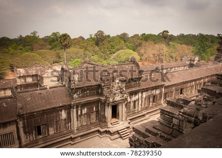 Ancient stone wall on the hill in the temple, Angkor Wat, Cambodia