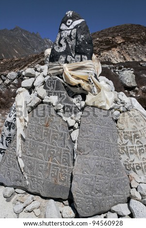 Ancient stones carved with the buddhist mantras near Dingboche - Nepal, Himalayas