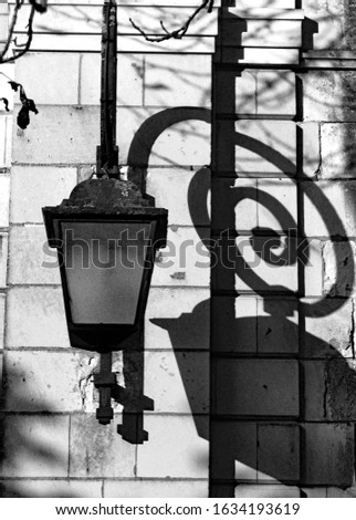 Ancient street lamp and shadows