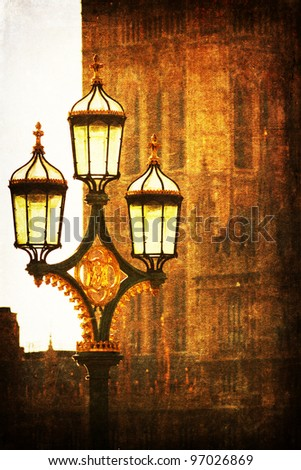 ancient street lamp in front of a part of the palace of Westminster in London