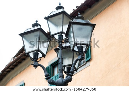 ancient street lamps typical of a country in Italy