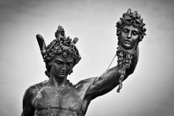 Ancient style sculpture of Perseus with the Head of Medusa in Loggia dei Lanzi in Florence, Italy. Black and white, head close-up