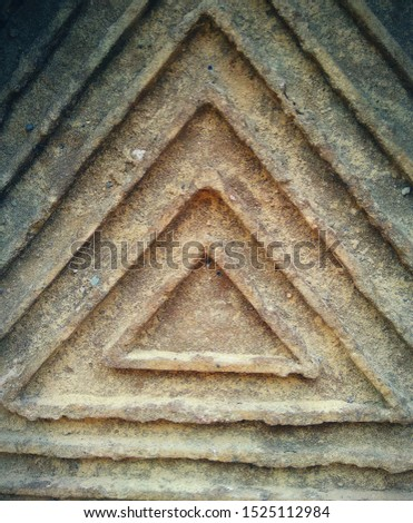 Ancient symbol on concrete wall.