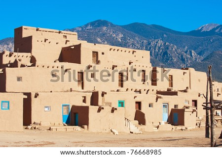 Ancient Taos Pueblo with mountains on background, New Mexico