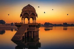 Ancient temple ruins at Gadi Sagar lake Jaipur Rajasthan at sunrise