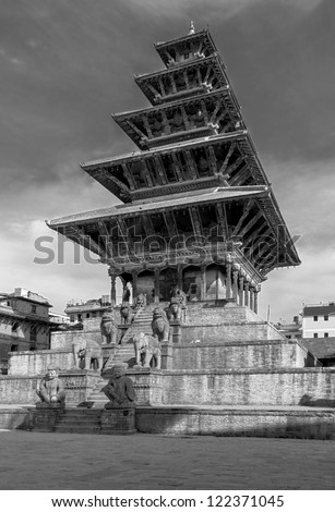 Ancient temple with the statues in the Bhaktapur - Nepal, Himalayas (black and white)