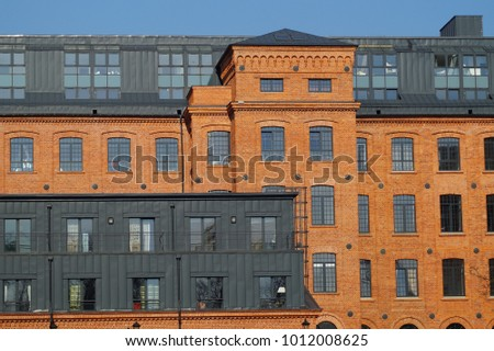 Ancient textile factory - details of architecture of the city of Lodz, Poland. Loft Aparts Tymienieckiego street - revitalized buildings #1012008625