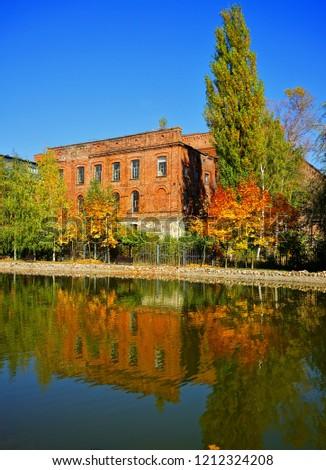 Ancient textile factory - details of architecture of the city of Lodz, Poland. Loft Aparts.
