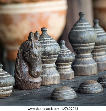 Ancient Thai wooden chess were lined on the board