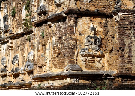 Ancient the wall brick of temple 7 tops pagoda have sculpture damaged in county of Chiang Mai, Thailand,
