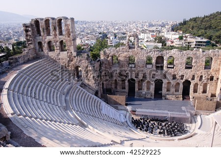 Ancient theatre of Herodes Atticus  is a small building of ancient Greece used for public performances of music and poetry, below on the Acropolis and in background dwelling of metropolis Athens - stock photo