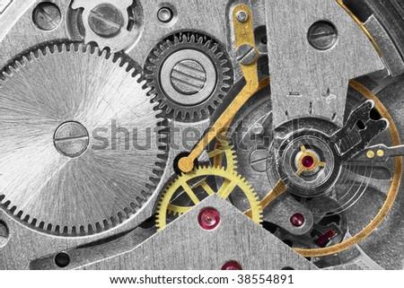 Ancient tiny metal clockwork close up background