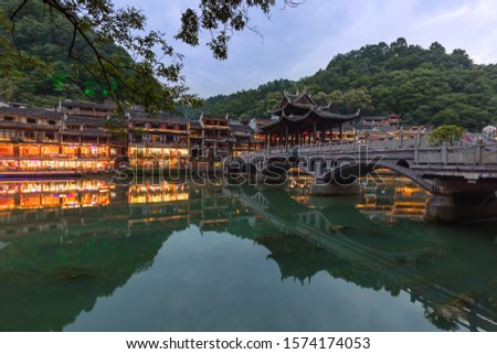 Ancient town Fenghuang at sunset in Hunan China - architecture background