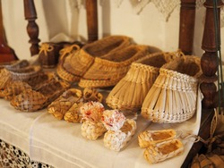 ancient traditional Shoe craft, woven from wood materials and birch bark natural Russian bast shoes as a Museum exhibit, modern handmade antique, shoes made of wood, culture of Eastern Europe