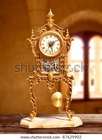 ancient vintage brass pendulum clock in old house interior