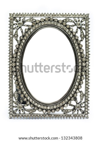 Ancient vintage picture frame made of jewel jewelry decoration and silver ornament material texture in white isolated background for scrapbook album