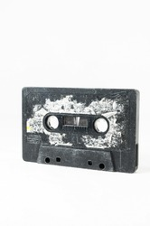Ancient Vintage Used Musicassette over a White Background