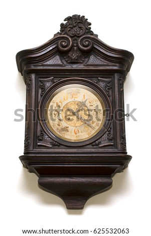 Ancient wall clock from carved wood #625532063