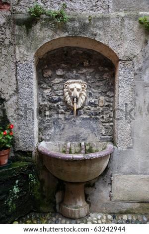 Ancient water fountain, Bellagio, Lake Como, Italy