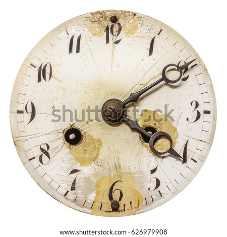 Ancient weathered clock face with cracks isolated on a white background