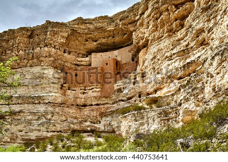 Ancient well preserved Native American cliff dwelling in side of mountain made out of stone, rock, mud, clay, fieldstone