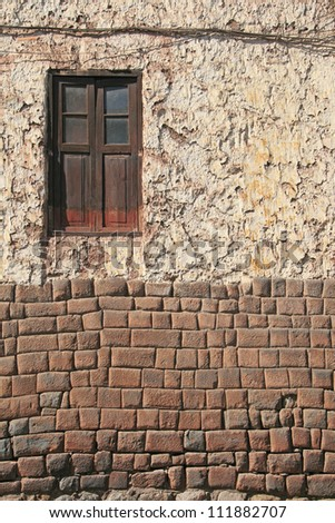 Ancient window and wall. Inca architecture street in Cuzco, Peru