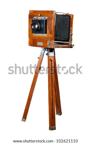 Ancient wooden camera. It is isolated on a white background