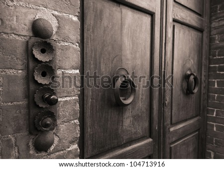 Ancient wooden door detail lock - stock photo