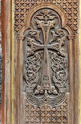 Ancient wooden door. Facade of the temple Armenia.
